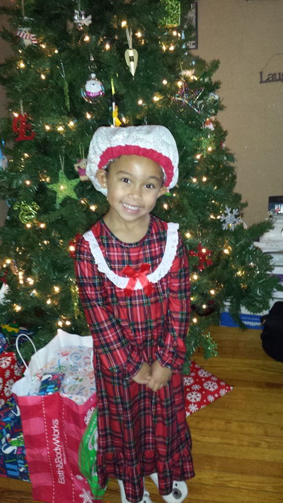 Holiday Gift Guide - Multiracial Kids / Curly Hair Care Edition - by Mixed Family Life for Multiracial MediaChristmas with the Thermal Cap on by herself