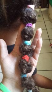 Wacky Hair Style that ended up Cute and Easy by Mixed Family Life for Multiracial Media _ Hair Tie Close up